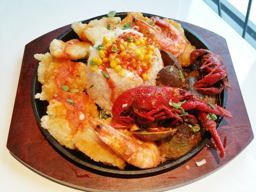 Dish teriyaki sizzling plate with rice and seafood