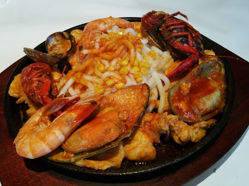 Chicken terayaki and seafood sizzling plate with udon