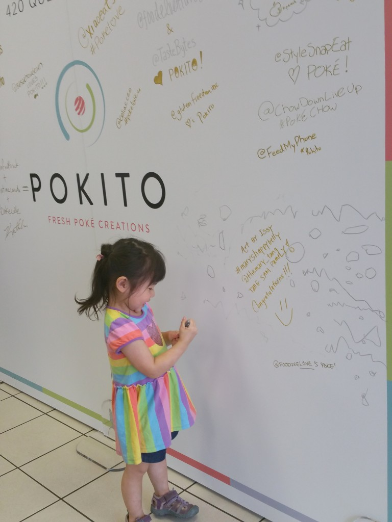 My daughter putting her signature on the Pokito board #maryshappybelly